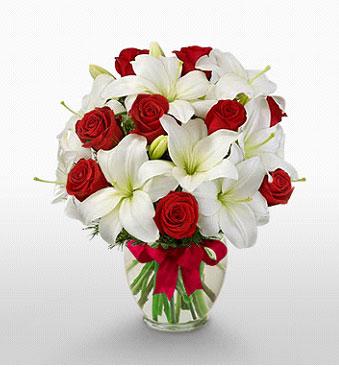 Zonguldak hediye çiçek yolla  1 dal kazablanka 11 adet kırmızı gül vazosu